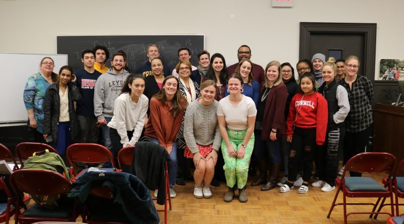 Michelle Day stands with students in the Community Action Gateway and community partners after her workshop on trauma-informed community engagement.